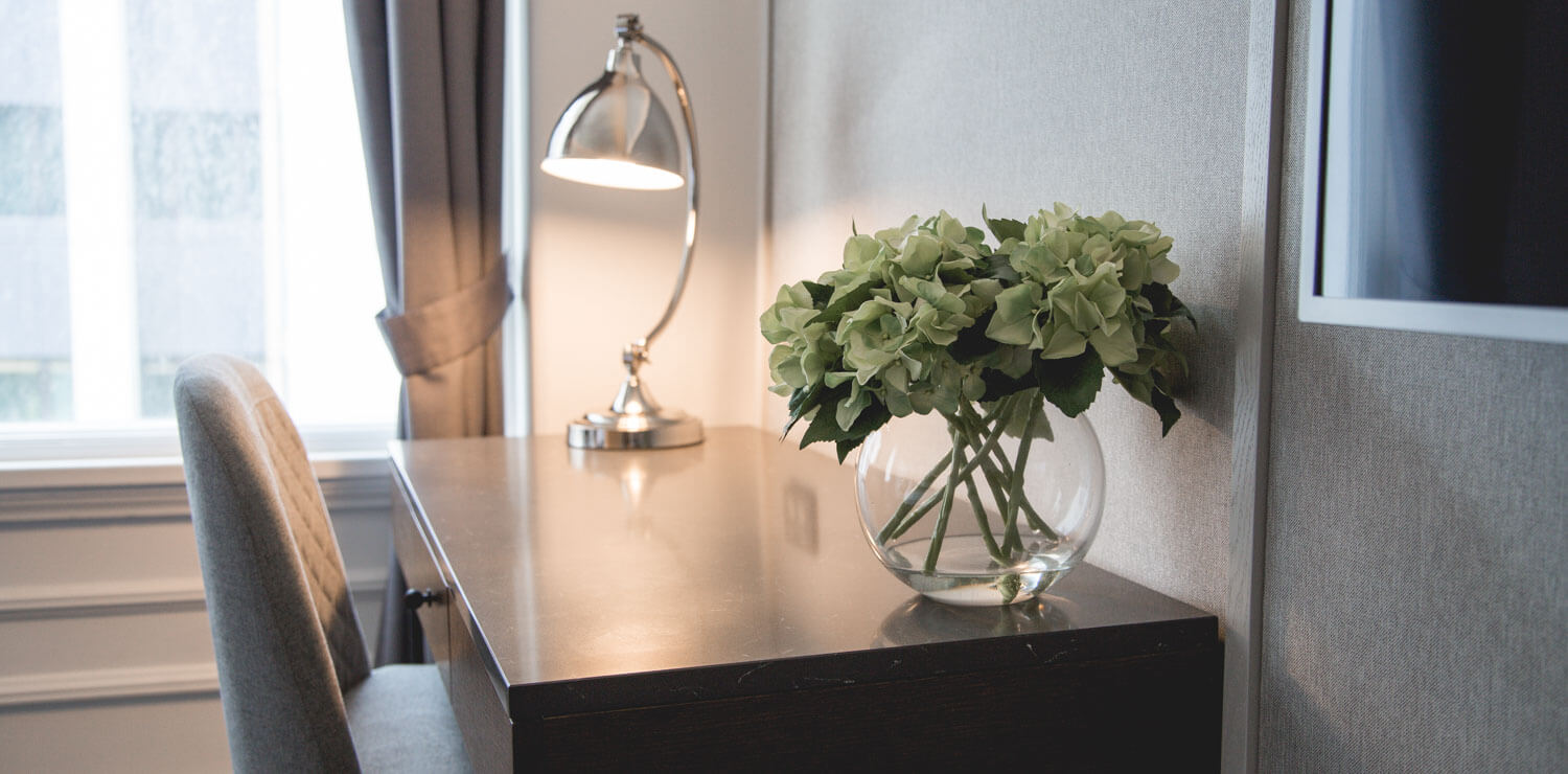 desk-in-room-lamp-pot-flowers | The Savoy Hotel on Little Collins