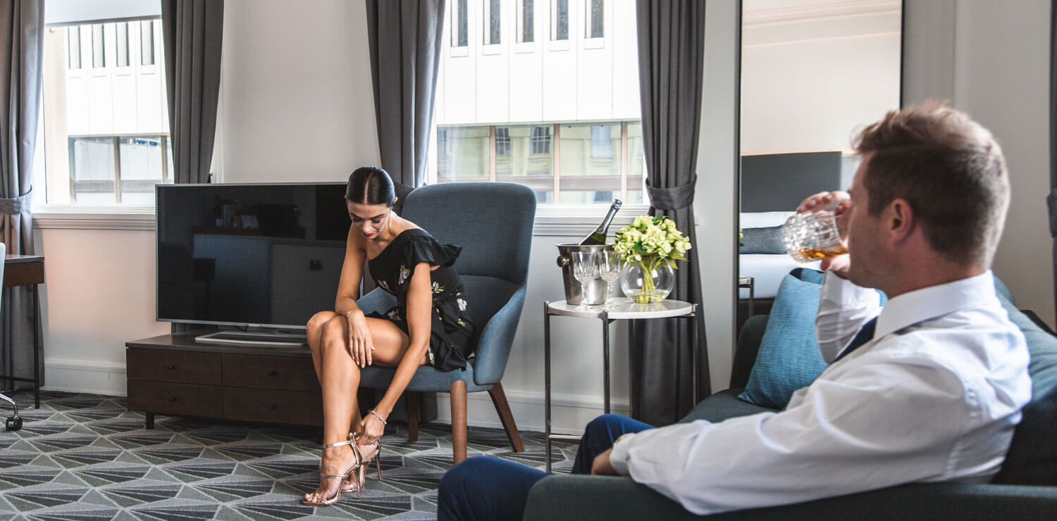 man-and-woman-getting-ready-hotel-room | The Savoy Hotel on Little Collins