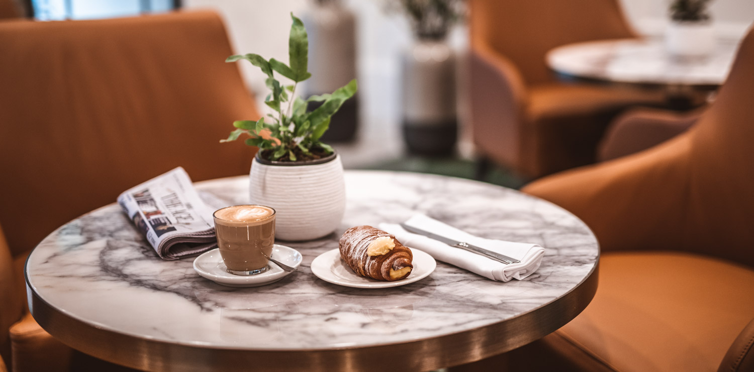 pastry-and-coffee-sitting-on-restaurant-table | The Savoy Hotel on Little Collins