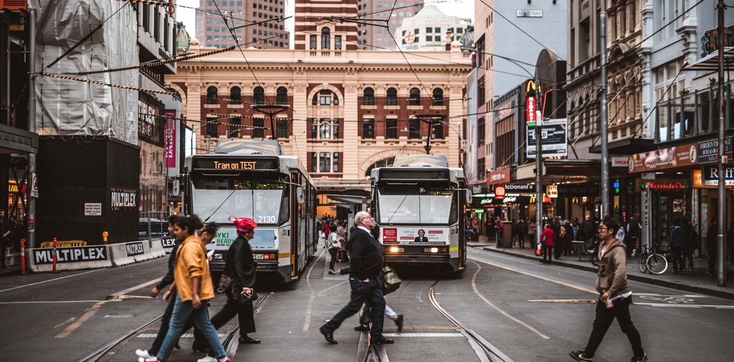 people-crossing-road-trams-melbourne-cbs-street | The Savoy Hotel on Little Collins